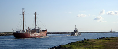 Nantucket / LV-112 being towed by the tugboat Lynx, heading east-bound from Oyster Bay, Long Island, NY to Boston on the Cape Cod Canal, May 2010.